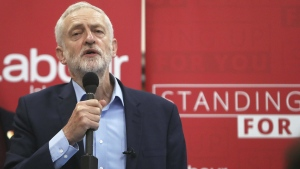 Britain's Labour Party leader Jeremy Corbyn delivers a speech at the Central Community Centre in Swindon, England during Labour's election campaign Friday April 21, 2017. (Steve Parsons/PA via AP)