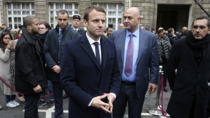 French centrist presidential candidate Emmanuel Macron attends a ceremony for slain police officer Xavier Jugele, at the Paris Police headquarters, Tuesday, April 25, 2017.  (AP / Thibault Camus, Pool)