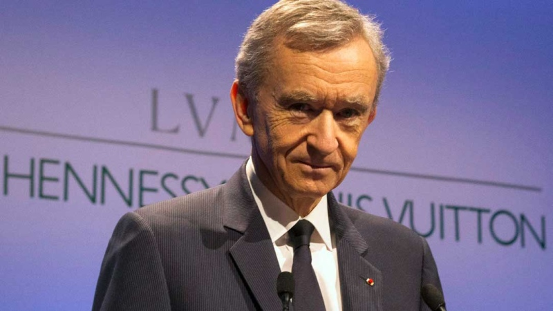 Bernard Arnault, Chairman and CEO of LVMH, 'Louis Vuitton Moet Hennessy,' the Paris-based luxury goods empire, poses prior to the presentation of the 2014 year results in Paris, France, Tuesday, Feb. 3, 2015. (AP Photo/Francois Mori)