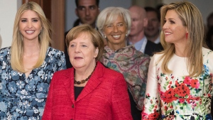Ivanka Trump, daughter and adviser of U.S. President Donald Trump, left, arrives with Queen Maxima of the Netherlands, right, German Chancellor Angela Merkel, centre, and Christine Lagarde, Managing Director of the International Monetary Fund, at the Woman 20 Dialogue summit for the empowerment of women in Berlin, Germany, Tuesday, April 25, 2017. (Michael Kappeler / dpa via AP)