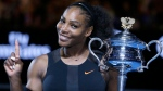Serena Williams holds up a finger and her trophy after defeating her sister, Venus, in the women's singles final at the Australian Open tennis championships in Melbourne, Australia on Jan. 28, 2017. (Aaron Favila/AP)