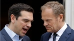 Greek Prime Minister Alexis Tsipras, left, speaks with European Council President Donald Tusk after their meeting at Maximos Mansion in Athens, April 5, 2017. (Thanassis Stavrakis/AP)