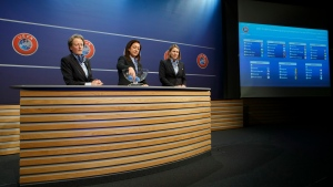 Nadine Kessler removes the balls containing the names of the soccer national teams, during the drawing of the matches for the 2017-19 European Qualifying Competition for the Women's Soccer World Cup at the UEFA Headquarters in Nyon, Switzerland, April 25, 2017. (Salvatore Di Nolfi/Keystone via AP)