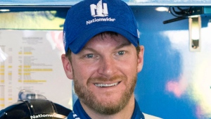 In this March 3, 2017, file photo, Dale Earnhardt Jr. smiles in the garage during practice for the NASCAR Monster Energy Cup auto race at Atlanta Motor Speedway in Hampton, Ga. (John Amis/AP)