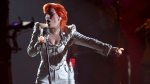 In this Feb. 15, 2016, file photo, Lady Gaga performs a tribute to David Bowie at the 58th annual Grammy Awards in Los Angeles. Gaga's tribute won a pair of Webby Awards announced on April 25, 2017. (Matt Sayles/Invision/AP)
