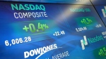 Electronic screens display stock index values at the Nasdaq MarketSite, on April 25, 2017, in New York. (Mark Lennihan / AP)