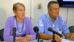 In this April 19, 2017, file photo, Hawaii Health Director Virginia Pressler, left, and Hawaii Tourism Authority CEO George Szigeti, right, talk to members of the media about new cases of rat lungworm disease in Honolulu. (Cathy Bussewitz/AP)