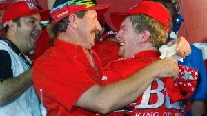 In this May 20, 2000, file photo, Dale Earnhardt, left, embraces his son Dale Earnhardt Jr., right, in victory lane after Dale Earnhardt Jr won The Winston All-Star auto race at Lowe's Motor Speedway in Concord, N.C. (AP / Chuck Burton)