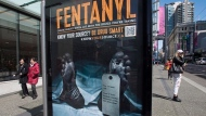 """An anti-fentanyl advertisment is seen on a sidewalk in downtown Vancouver, Tuesday, April, 11, 2017. A tag hanging from a dead man's left toe says the cause of death was an overdose of fentanyl, """"unknowingly taken with other drugs."""" (THE CANADIAN PRESS/Jonathan Hayward)"""