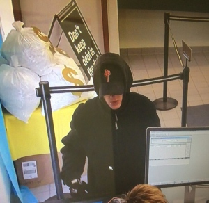 A man who police say robbed a bank in Moose Jaw on Tuesday, April 25, 2017 is seen in this image captured from surveillance video. (MOOSE JAW POLICE SERVICE)
