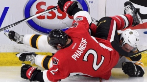 FILE - In this April 12, 2017, file photo, Boston Bruins left wing Brad Marchand (63) and Ottawa Senators defenseman Dion Phaneuf (2) get tangled up during the third period of the first round of NHL Stanley Cup playoff hockey action in Ottawa. Phaneuf told general manager Pierre Dorion the opening series against the Bruins was the toughest he has ever been through.(Sean Kilpatrick/The Canadian Press via AP, FILE)