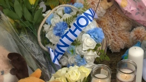 Flowers are seen at a vigil for 19-month-old Anthony Raine, whose body was found near an Edmonton church last week.