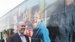 B.C. NDP leader John Horgan walks back to his campaign bus following a media availability in Burnaby, B.C., Tuesday, April 25, 2017. THE CANADIAN PRESS/Jonathan Hayward