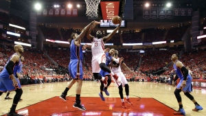 Houston Rockets' James Harden (13) goes up for a shot as Oklahoma City Thunder's Steven Adams defends during the second half in Game 5 of an NBA basketball first-round playoff series, Tuesday, April 25, 2017, in Houston. (AP / David J. Phillip)