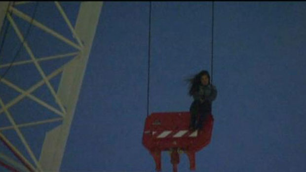 Woman stuck on crane's pulley at Toronto's Church and Wellesley streets