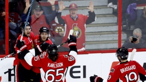 Ottawa Senators right wing Mark Stone (61) celebrates his goal with teammates Erik Karlsson (65) and Mike Hoffman (68) as Derick Brassard (19) skates up during first period game five NHL Stanley Cup playoff action against the Boston Bruins, in Ottawa on Friday, April 21, 2017. THE CANADIAN PRESS/Fred Chartrand