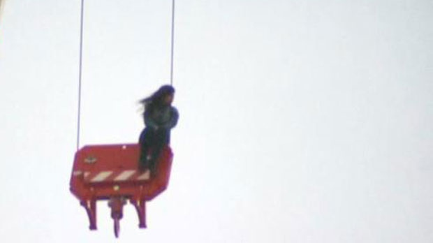 A woman is trapped on a crane near Church and Wellesley streets.