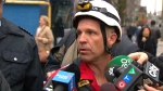 Toronto firefighter Rob Wonfor speaks with reporters after a daring crane rescue on Wednesday, April 26, 2017.