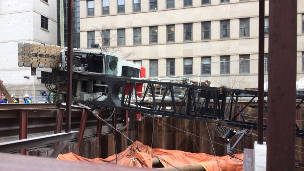 A crane fell on its side at the LRT tunnel entrance near the University of Ottawa on Wednesday.