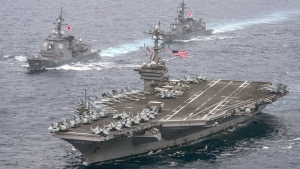 In this photo released by the U.S. Navy, the aircraft carrier USS Carl Vinson, foreground, transits the Philippine Sea with the Japan Maritime Self-Defense Force Atago-class guided-missile destroyer JS Ashigara, left front, and the JMSDF Murasame-class destroyer JS Samidare. (Mass Communication Specialist 2nd Class Sean M. Castellano / U.S. Navy via AP)