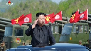 """This image made from video of a still image broadcast in a news bulletin by North Korea's KRT on Wednesday, April 26, 2017, shows leader Kim Jong Un at what was said to be a """"Combined Fire Demonstration"""" held to celebrate the 85th anniversary of the North Korean army, in Wonsan, North Korea. (KRT via AP Video)"""