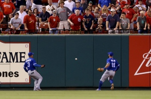 Toronto Blue Jays outfielders Ezequiel Carrera, left, and Kevin Pillar watch as a double by St. Louis Cardinals' Stephen Piscotty bounces over the all during the fourth inning of a baseball game Tuesday, April 25, 2017, in St. Louis. (Christian Gooden/St. Louis Post-Dispatch via AP)