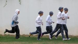 Members of a Saudi female soccer team practice at a secret location in Riyadh, Saudi Arabia on May 21, 2012. (Hassan Ammar/AP)