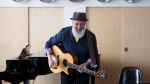 "Canadian musician Fred Penner plays a song off his new album ""Hear The Music,"" to children at the Regent Park School of Music in Toronto on April 25, 2017. (Cole Burston/THE CANADIAN PRESS)"