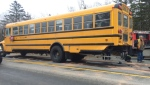 Three children have been sent to hospital after their school bus was rear-ended by a truck.