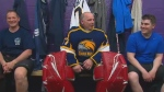 crane rescuer hailed as a hero, plays hockey game