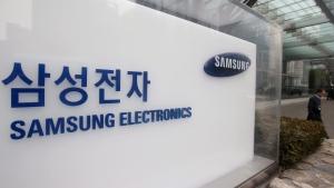 A man walks by Samsung Electronics' headquarters in Seoul, South Korea, Thursday, Jan. 28, 2016. (Lim Hun-jung/Yonhap via AP)