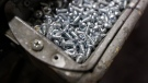In this Jan. 17, 2017, photo, machine screws are seen in a bin at Corn Belt Aluminum in Des Moines, Iowa. (AP Photo/Charlie Neibergall)