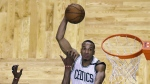 Boston Celtics guard Avery Bradley lines up a dunk over Chicago Bulls forward Jimmy Butler during the fourth quarter of a first-round NBA playoff basketball game in Boston on Wednesday, April 26, 2017. (AP / Charles Krupa)