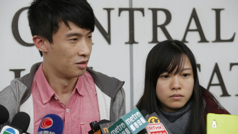 Pro-independence lawmakers Sixtus Leung, left, and Yau Wai-ching speak to the media outside a police station after being released on bail in Hong Kong on Wednesday, April 26, 2017. (AP / Kin Cheung)