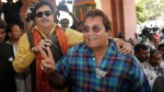 In this May 20, 2014, file photo, former Indian politician and Bollywood actor Vinod Khanna, right, and Indian film actor turned politician Shatrughan Sinha pose for cameras as they arrive for the BJP parliamentary party meeting in New Delhi, India. (AP Photo/Saurabh Das, File)