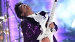 Bruno Mars performs a tribute to Prince onstage during the 59th Annual Grammy music Awards on February 12, 2017, in Los Angeles, California (VALERIE MACON / AFP PHOTO)