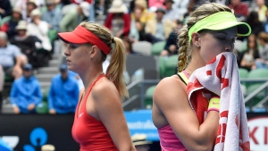 Eugenie Bouchard, right, and Maria Sharapova at the Australian Open tennis championship in Melbourne on Jan. 27, 2015. (Andy Brownbill / AP)