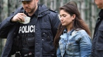Marisa Lazo escorted by Toronto police on April 26, 2017. (Frank Gunn / THE CANADIAN PRESS)