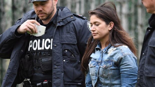 Marisa Lazo escorted by Toronto police on April 26, 2017. (Frank Gunn / THE CANADIAN PRESS)