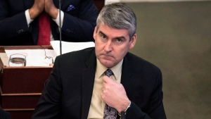 Nova Scotia premier Stephen McNeil adjusts his tie as the budget is presented at the legislature in Halifax on Thursday, April 27, 2017. (THE CANADIAN PRESS/Darren Calabrese)