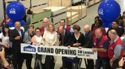 London Mayor Matt Brown is in the center, cutting the board in London, Ont. (Courtesy Lowe's Canada)
