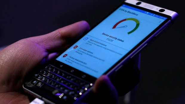A man touches the new BlackBerry KEYone before the Mobile World Congress in Barcelona, Spain, Saturday, Feb. 25, 2017. (Manu Fernandez/AP)
