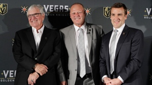 Vegas Golden Knights coach Gerard Gallant is flanked by Bill Foley, left, owner of the Vegas Golden Knights, and George McPhee, Vegas Golden Knights general manager, in Las Vegas on April 13, 2017. (John Locher/AP)