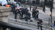 Police arrest a man on the pavement in Whitehall, London, Thursday April 27, 2017. London police say they have arrested a man for possession of offensive weapons near Britain's Houses of Parliament. (Dev Howard via AP)