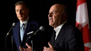 Conservative Party leadership candidate Maxime Bernier (left) looks on as Kevin O'Leary address a news conference in Toronto, Wednesday, April 26, 2017. (Nathan Denette / THE CANADIAN PRESS)