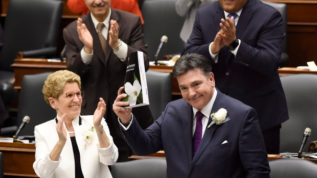 Ontario Finance Minister Charles Sousa, right, delivers the 2017 Ontario budget next to Premier Kathleen Wynne at Queen's Park in Toronto on Thursday, April 27, 2017. (THE CANADIAN PRESS / Nathan Denette)