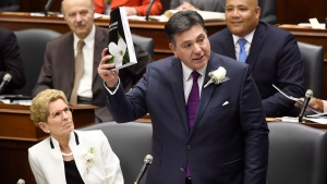 Ontario Finance Minister Charles Sousa, right, delivers the 2017 Ontario budget next to Premier Kathleen Wynne at Queen's Park in Toronto on Thursday, April 27, 2017. (Nathan Denette / THE CANADIAN PRESS)