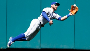 Toronto Blue Jays center fielder Kevin Pillar is unable to hold on to a double by St. Louis Cardinals' Dexter Fowler during the eighth inning in the first game of a baseball doubleheader Thursday, April 27, 2017, in St. Louis. (AP Photo / Jeff Roberson)
