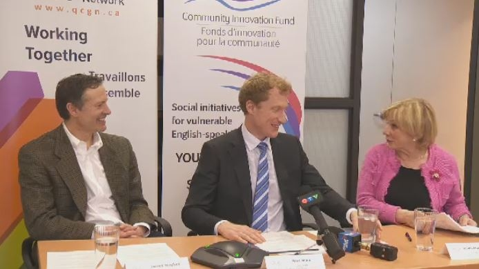 Liberal MP Marc Miller (centre) made the announcement Thursday.