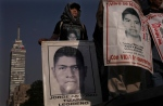 Relatives of 43 missing college students from Mexico's Guerrero state mark the 31 month since their disappearances, with a march in Mexico City, Wednesday, April 26, 2017. (AP / Marco Ugarte)